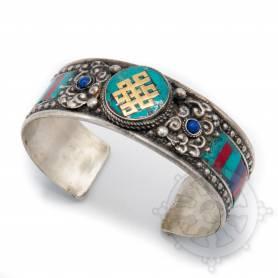 Bracelet argenté incrusté de pierres couleurs turquoises- Noeud de l'infini
