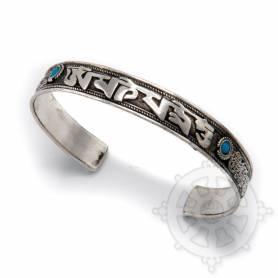Bracelet argenté incrusté de petites pierres turquoises - OM MANI