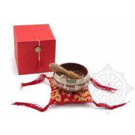 Idée cadeau incluant un bol de méditation rouge avec coussin coordonné et stick !