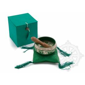 Idée cadeau incluant un bol de méditation vert avec coussin coordonné et stick !
