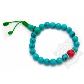 Malas pour poignet composé de 20 perles turquoise(8mm) 1 corail(10mm)
