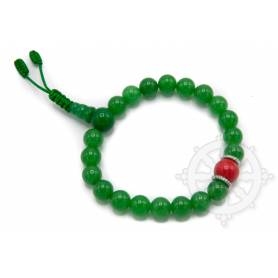 Malas pour poignet composé de 20 perles jade(8mm) 1 corail(10mm)