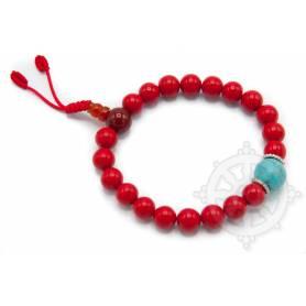 Malas pour poignet composé de 20 perles corail(8mm), 1 turquoise(10mm)