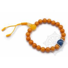 Malas pour poignet composé de 20 perles ambre(8mm), 1 lapis-lazuli(10mm)